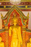 Beautiful large standing golden Buddha image with ceiling interior decoration, named Phra Chao Attarot at Wat Chedi Luang (temple royalty free stock photography