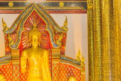 Beautiful large standing golden Buddha image with ceiling interior decoration, named Phra Chao Attarot at Wat Chedi Luang (temple stock photo