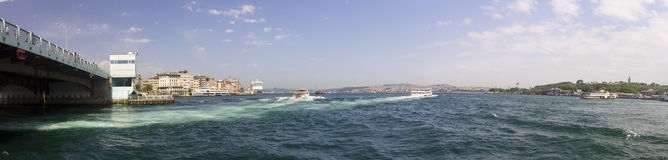 Beautiful late afternoon view on Istanbul city with a large bridge on the left Royalty Free Stock Photos