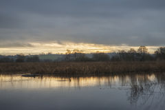 Beautiful late Winter sunset over wetlands lake landscape Stock Photo