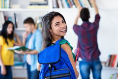 Beautiful latin american female student with group of students stock photography