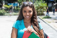Beautiful latin american female student. Outdoor in the city Stock Images