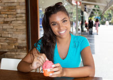 Beautiful latin american woman with ice cream. Outdoor in the summer in the city Royalty Free Stock Image