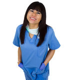 Beautiful latin female doctor smiling. Friendly female doctor smiling with her hands in pockets Stock Photos