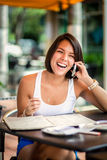Beautiful latin girl on the phone Royalty Free Stock Photography