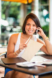 Beautiful latin girl on the phone Stock Photography