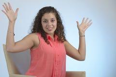 Beautiful latin girl saying hurray. Beautiful latin girl with curly hair saying hurray Stock Photo
