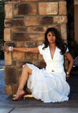 Beautiful Latin Woman. Beautiful Woman posing in a white dress stock image