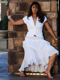 Beautiful Latin Woman. Beautiful Woman Posing in a white dress royalty free stock image