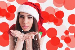 Beautiful latin woman fairy blowing magical glitter at christmas day. Stock Photography