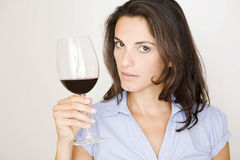 Beautiful latin woman with a glass of red wine Royalty Free Stock Image