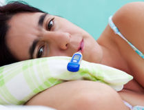 Beautiful latin woman sick in bed Royalty Free Stock Photo