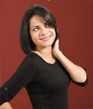 Beautiful latin woman smiling looking up Stock Photo