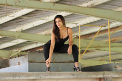 Beautiful Latina at an Abandoned Warehouse Royalty Free Stock Images