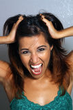 Beautiful Latina, Headshot (5). Close-up of a lovely, young, excited, and perhaps crazed Latina Royalty Free Stock Photos