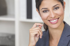 Beautiful Latina Hispanic Woman or Businesswoman. Portrait of a beautiful young Latina Hispanic woman or businesswoman wearing smart business suit in her office Royalty Free Stock Images