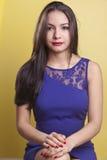 Beautiful latina model in a blue dress stock image
