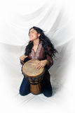 Beautiful Latina playing a Djembe Drum (2) Stock Photography