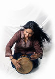Beautiful Latina playing a Djembe Drum (3) Royalty Free Stock Photos