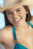 Beautiful Latina Woman in Bikini & Cowboy Hat. A sexy and beautiful young Latina Hispanic woman laughing in a bikini and straw cowboy hat with a swimming Stock Photography