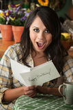 Beautiful Latina Woman with Birthday Card Stock Photography