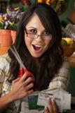 Beautiful Latina Woman with Coupons Stock Photography