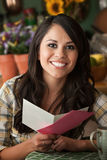 Beautiful Latina Woman with Greeting Card Royalty Free Stock Image