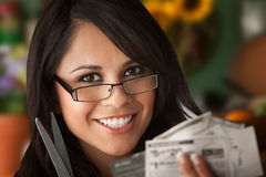 Beautiful Latina Woman With Coupons Royalty Free Stock Images