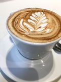 Beautiful Latte Art. This is a cup of coffee with leaf pattern Stock Images