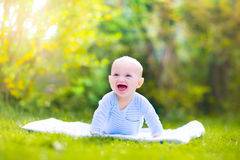 Beautiful laughing baby in the garden Royalty Free Stock Images