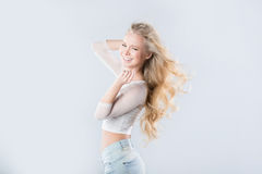 Beautiful laughing blonde hair in the wind. Royalty Free Stock Photography