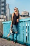 Beautiful laughing blonde  standing on a bridge Stock Photo