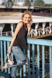Beautiful laughing blonde  standing on a bridge Royalty Free Stock Image
