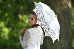 Beautiful laughing bride with decorative umbrella Royalty Free Stock Image