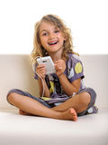 Beautiful laughing child girl with smartphone Royalty Free Stock Photos