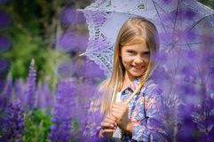 Beautiful laughing girl in a field of purple Royalty Free Stock Images