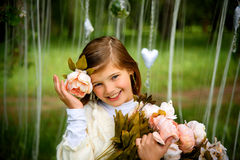Beautiful laughing girl with flowers Stock Photo