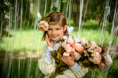 Beautiful laughing girl with flowers Royalty Free Stock Photos