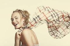 Beautiful laughing girl in jewelry and a scarf Stock Photo