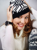 Beautiful laughing girl in a knitted cap Royalty Free Stock Photography