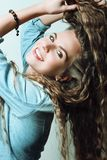 Beautiful laughing girl with magnificent hair