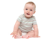Beautiful laughing happy baby boy sitting on bed Stock Images