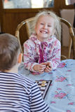 Beautiful laughing little girl playing checkers Royalty Free Stock Images