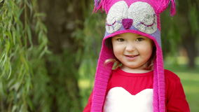 Beautiful laughing little toddler girl in a red coat stock video