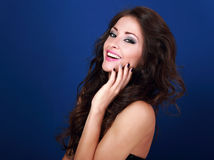 Beautiful laughing makeup woman with long volume hairdo and mani Stock Images