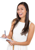 beautiful laughing secretary or student, businesswoman holding a clipboard Royalty Free Stock Photography