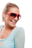 Beautiful laughing tanned woman in sunglasses Stock Image