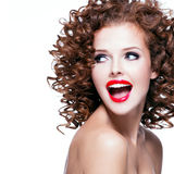 Beautiful laughing woman with brunette curly hair. Stock Images