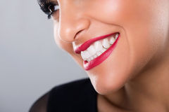 Beautiful laughing woman with red lips and white teeth, closeup Stock Images