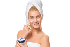 Beautiful laughing young woman with facial cream on her cheek Royalty Free Stock Image